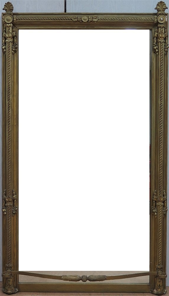 A mirror in gold coloured wooden frame mounted with gypsum eleme