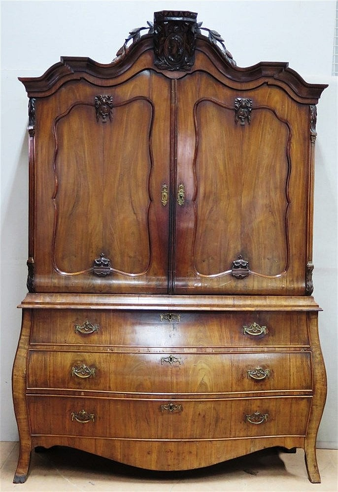 A mahogany cabinet. Lower part curved with three drawers. Hollan