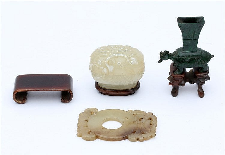 A Chinese jade bi disc, a carved box and cover and a dark gree