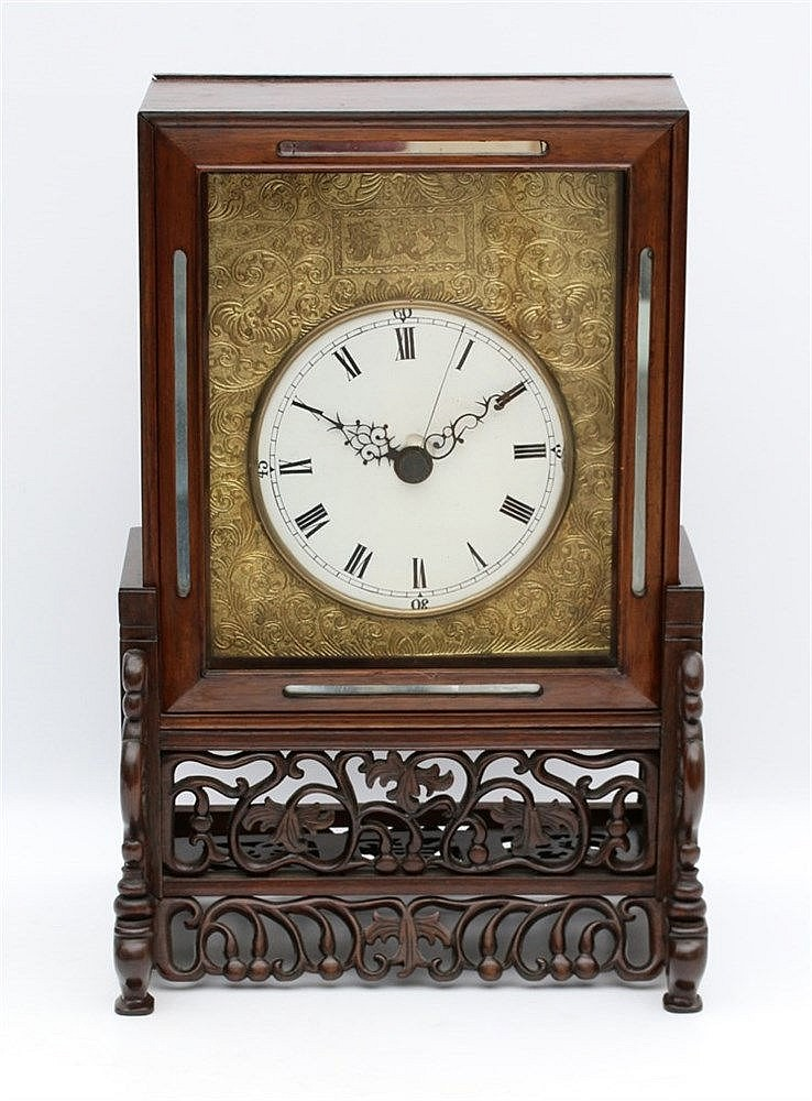 A Chinese hardwood mantel clock, the rectangular case with shape