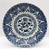 A Chinese blue and white dish decorated with a fan-shaped panel