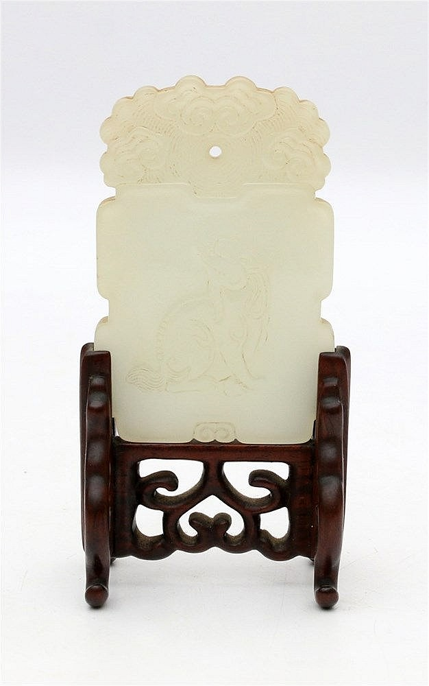 A Chinese jade rectangular plaque, the front carved with a qili
