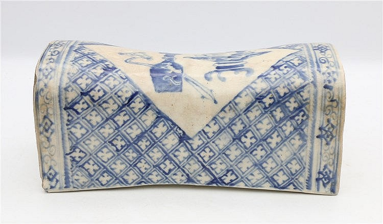A Chinese blue and white Ming-style head-rest, decorated with an