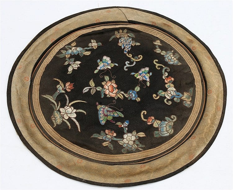 A Chinese blue silk roundel embroidered with peonies and butterf