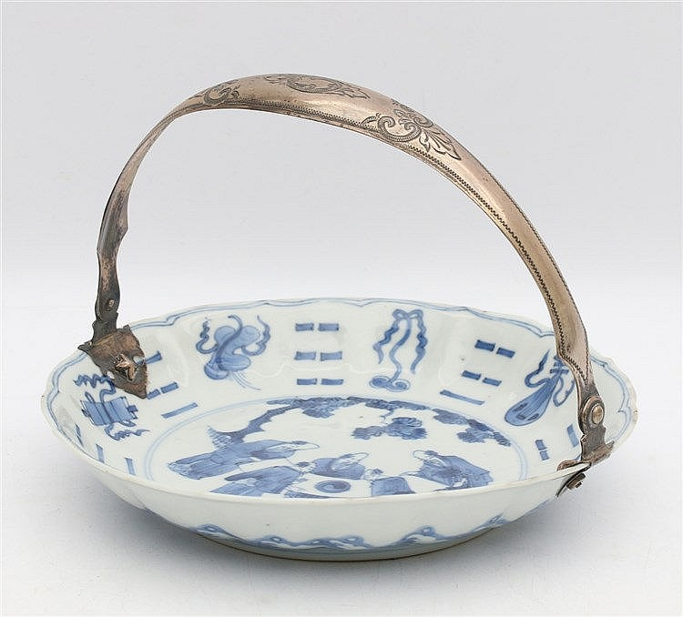A Chinese blue and white saucer decorated with five scholars stu