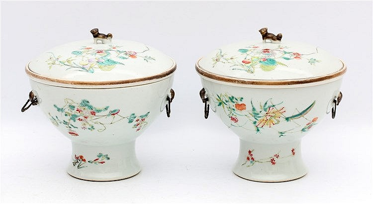 A pair of Chinese famille rose coupes and covers decorated with