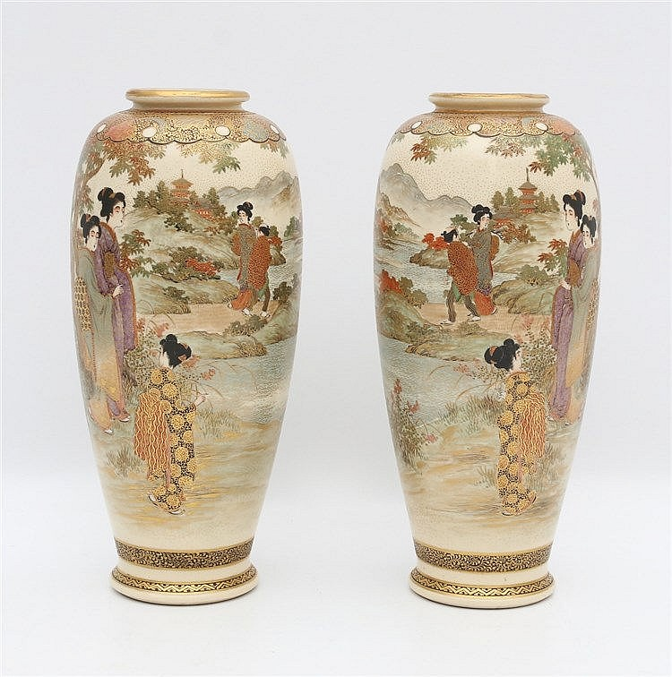 A pair of Japanese Satsuma vases decorated with geisha's in a ga
