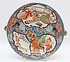 A set of three Japanese Imari hot water plates, each decorated w