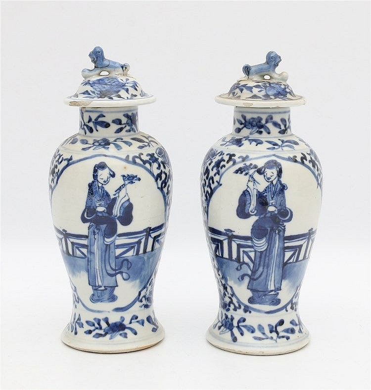 A pair of Chinese blue and white baluster vases and covers, deco