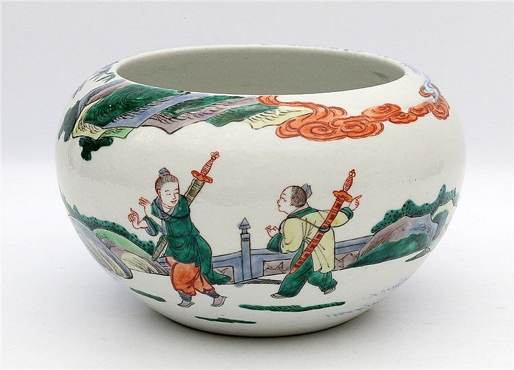 A Chinese blue and white and famille verte bowl decorated with f