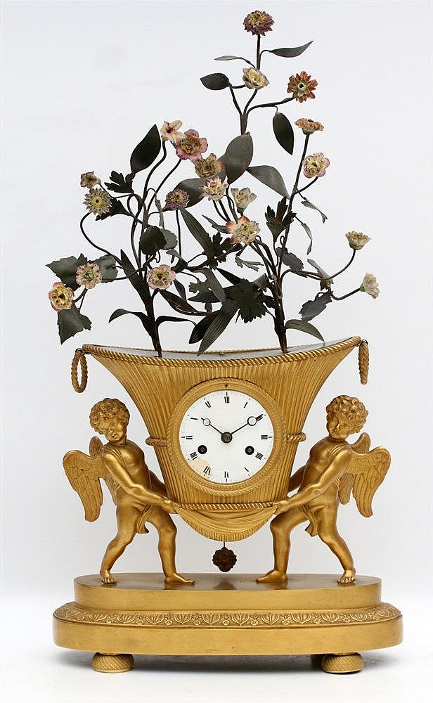 An Empire-style gilt bronze mantel clock, shaped as a jardinièr