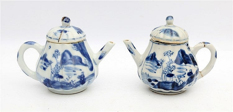 A pair of Chinese blue and white lobed pear-shaped teapots and c