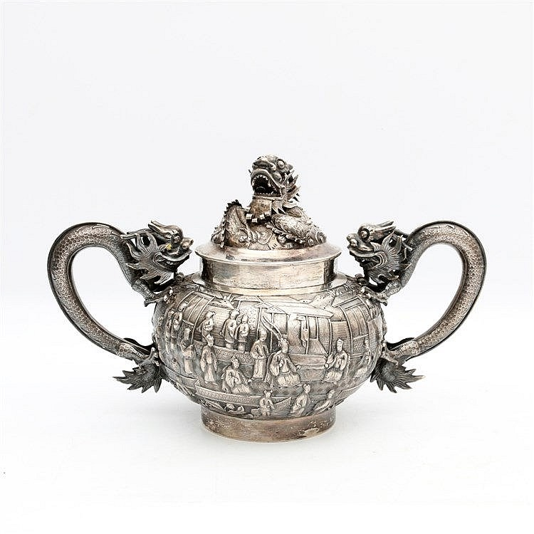 A Chinese silver sugar-bowl and cover, one side decorated with a