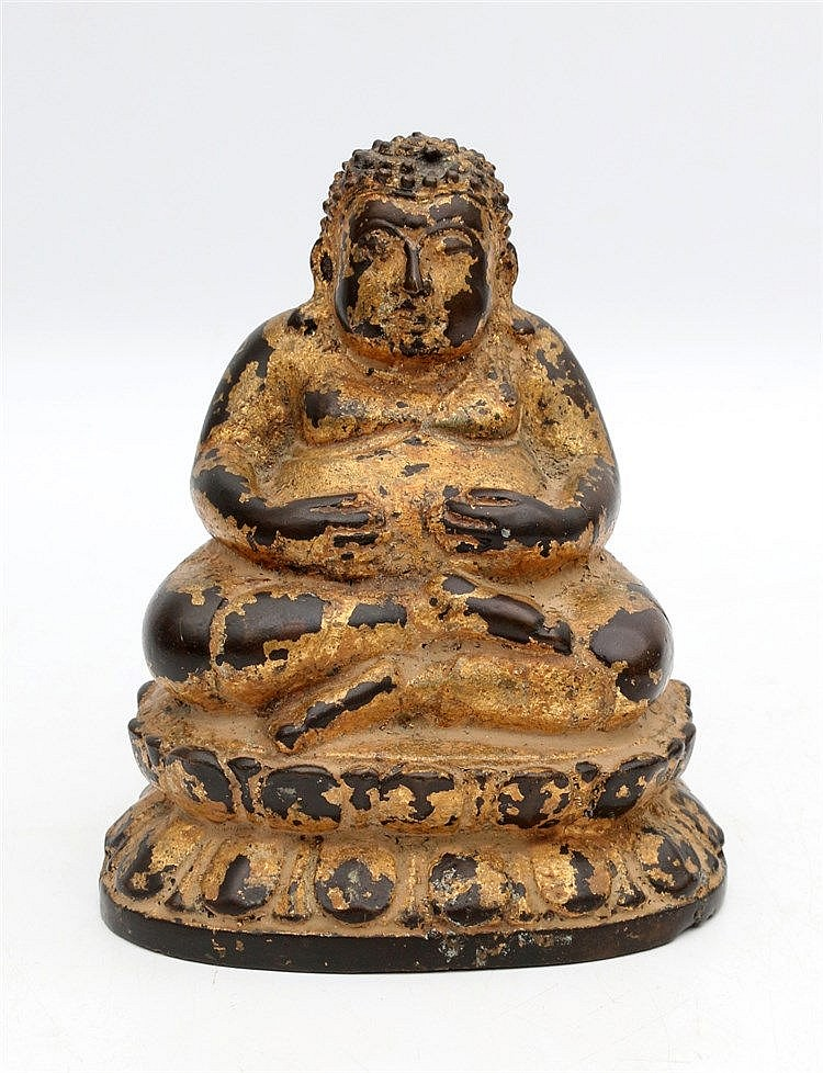 A Chinese gilt bronze figure of Budai seated on a double lotus t