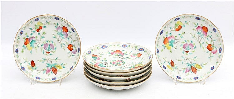 A set of seven Chinese famille rose saucers decorated with duria
