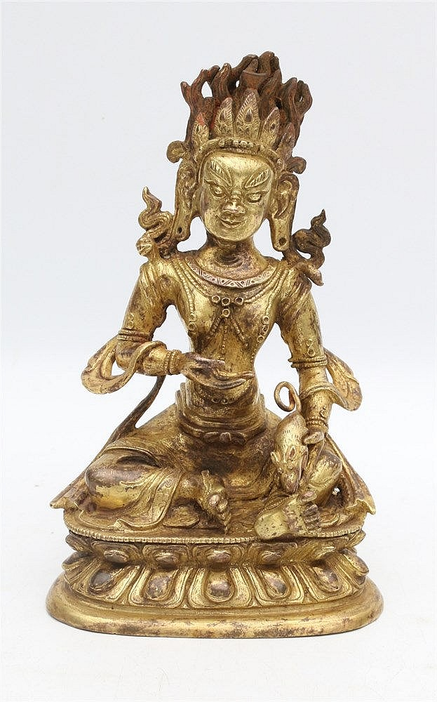 A Tibeto-Chinese gilt bronze sculpture of Jambhala, seated on a