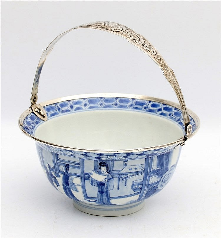 A Chinese blue and white bowl decorated with two scenes from the