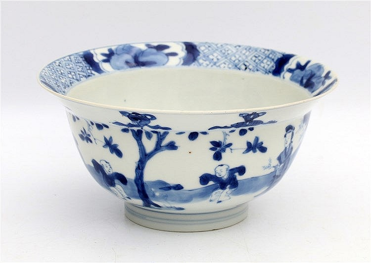 A Chinese blue and white bowl decorated with elegant ladies and