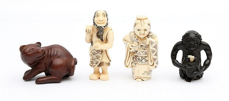 Two Japanese ivory netsuke, each carved as a standing figure. Ea
