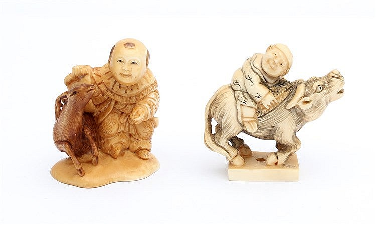 Two Japanese ivory netsuke, one carved as a karako on a buffal