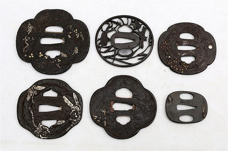 A collection of six Japanese iron tsuba's, comprising one with