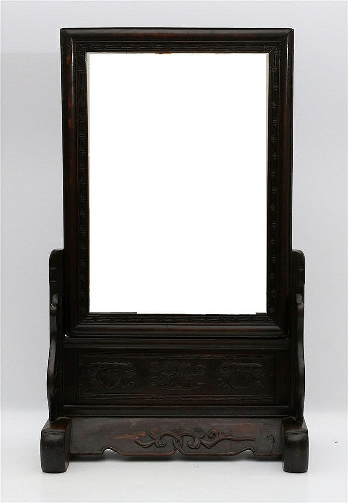 A Chinese wood mirror on stand, the stand carved with peach, lot