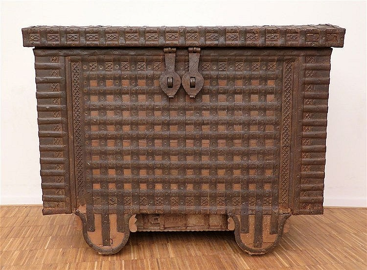 A wooden and iron Damchiya Dowry chest. India, ca. 1900. On wood