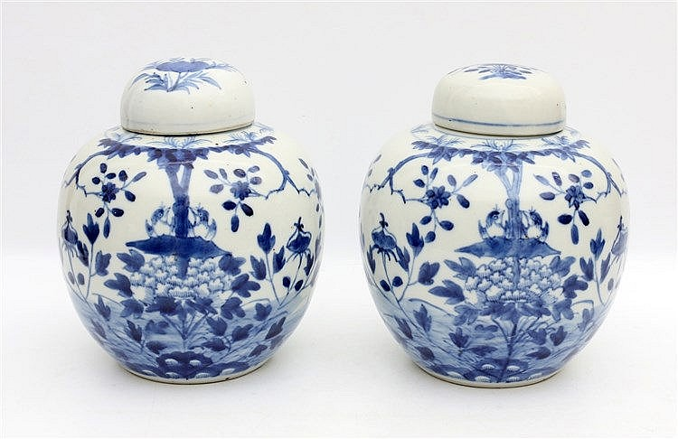 A pair of Chinese blue and white ginger jars and covers, decora