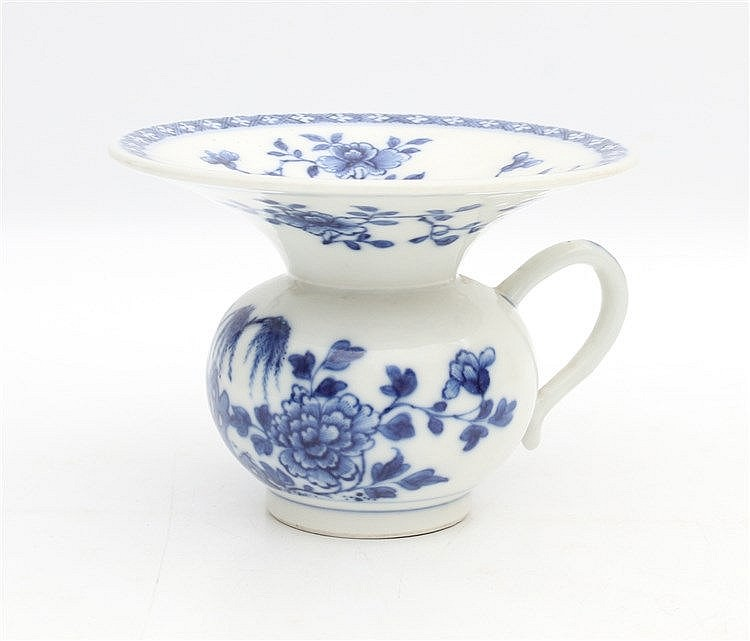 A Chinese blue and white spittoon decorated with bamboo and peon