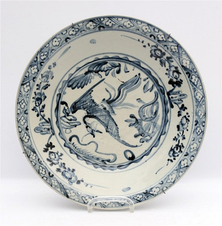 A Chinese blue and white dish decorated with a phoenix. Mid 17th