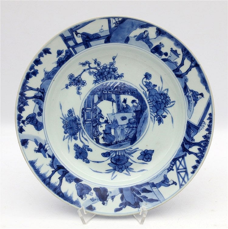 A Chinese blue and white plate, the bulbous central roundel dec