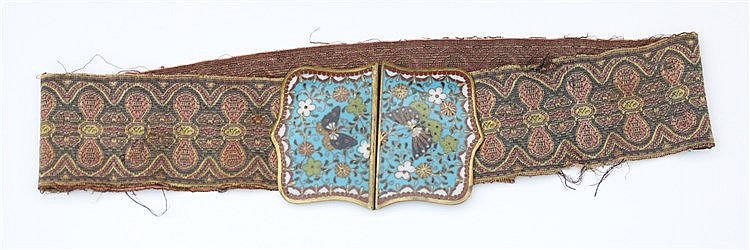 A Chinese cloisonné two-part belt buckle, on a silk woven band.