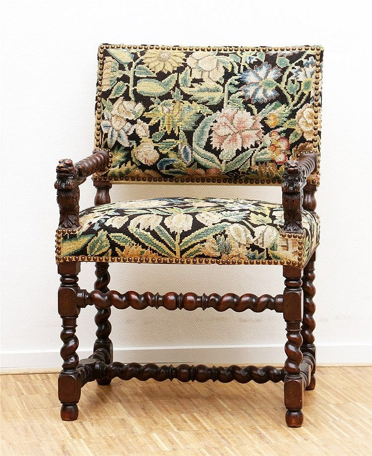 A mahogany armchair incised with lions. 18th/19th century. Hoog