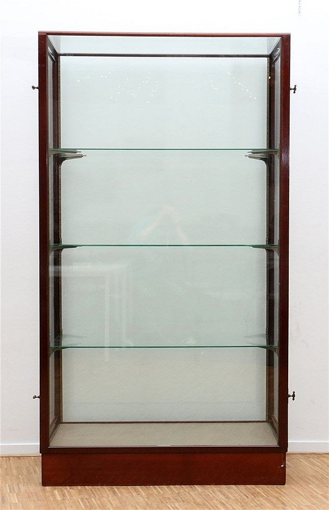 A mahogany two door display cabinet. Marked: Tacoma Fabrikant, A