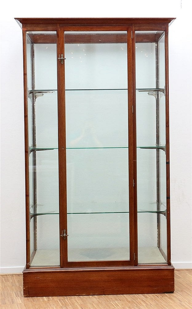 A mahogany one door display cabinet. Marked: Joh. Tacoma Fabrika