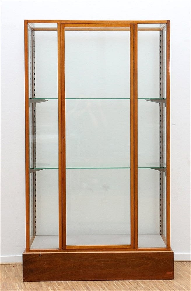 A one door cherry wood display cabinet. Ca. 1920. 179 x 104 x 54