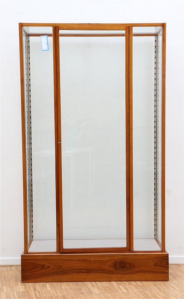 A cherrywood display cabinet. With one door. Ca. 1920. Identical
