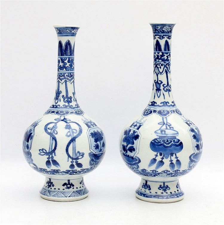 Two Chinese blue and white bottle vases, each decorated with pre