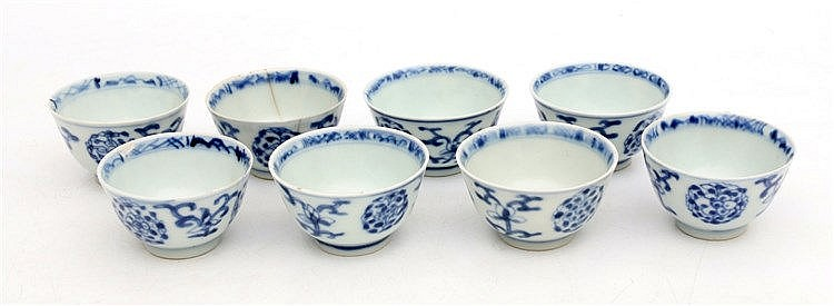 A set of eight Chinese blue and white cups decorated with flower