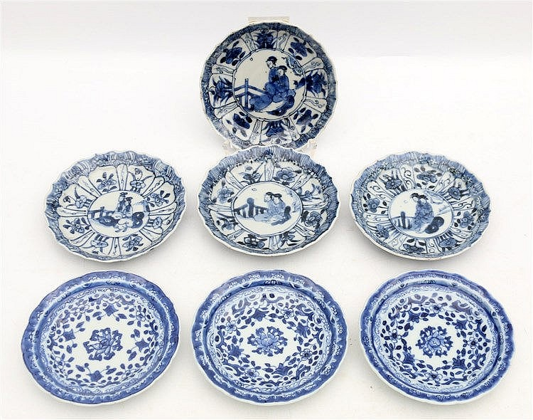 A set of four Chinese blue and white saucers decorated with ladi
