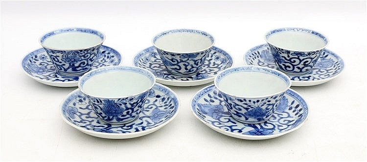 A set of five Chinese blue and white cups and saucers decorated