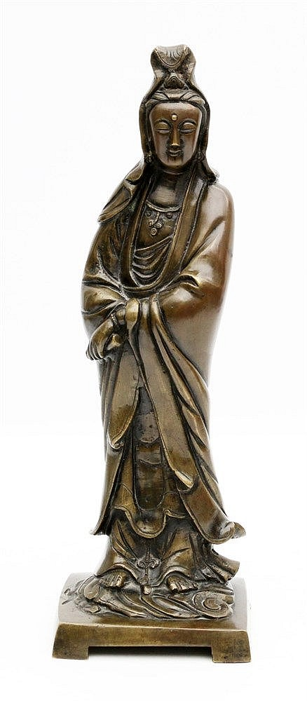 A Chinese bronze figure of Guanyin modelled in standing position