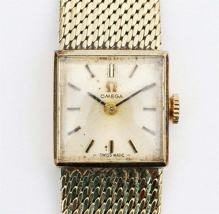 14 krt Yellow gold Omega ladies bracelet watch. Total weight 42.