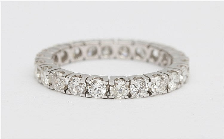 Diamond set eternity ring.  14 krt white gold, total diamond