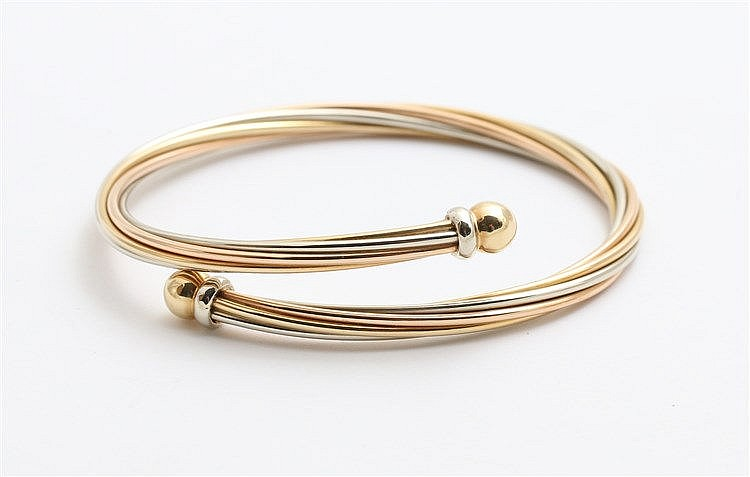 Tricolor 18 krt gold bangle.  Yellow, white and rose gold. We