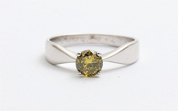 Greenish-yellow diamond set white gold ring.  Diamond weight 0