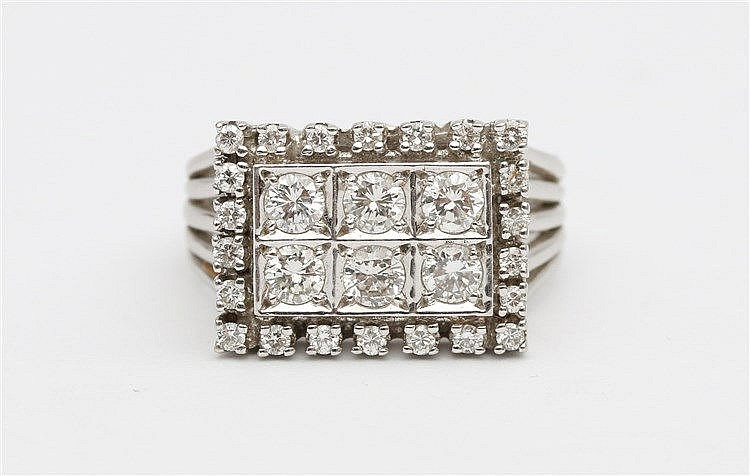 Diamond set 14 krt white gold ring.  Total diamond weight app