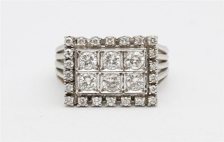 Diamond set 14 krt white gold ring. Total diamond weight app
