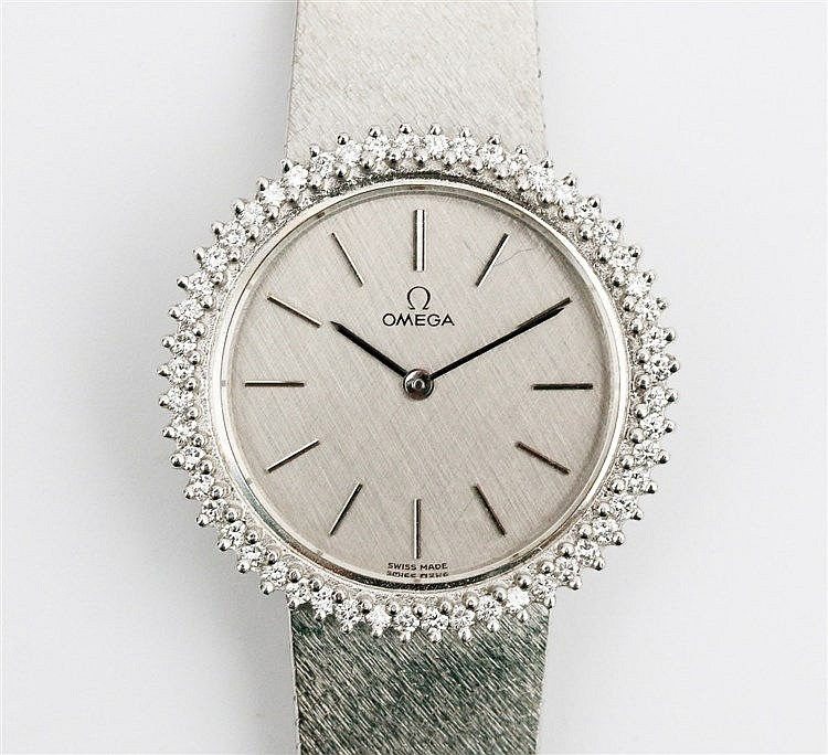 White gold ladies watch, Omega. Ref. nr. 7283. Bezel set with br