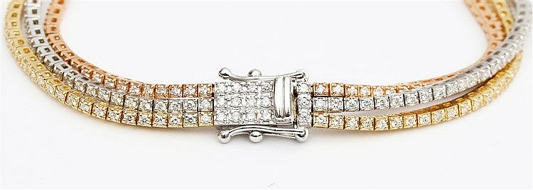 Diamond set gold bracelet. Three row 18 krt yellow, white and r